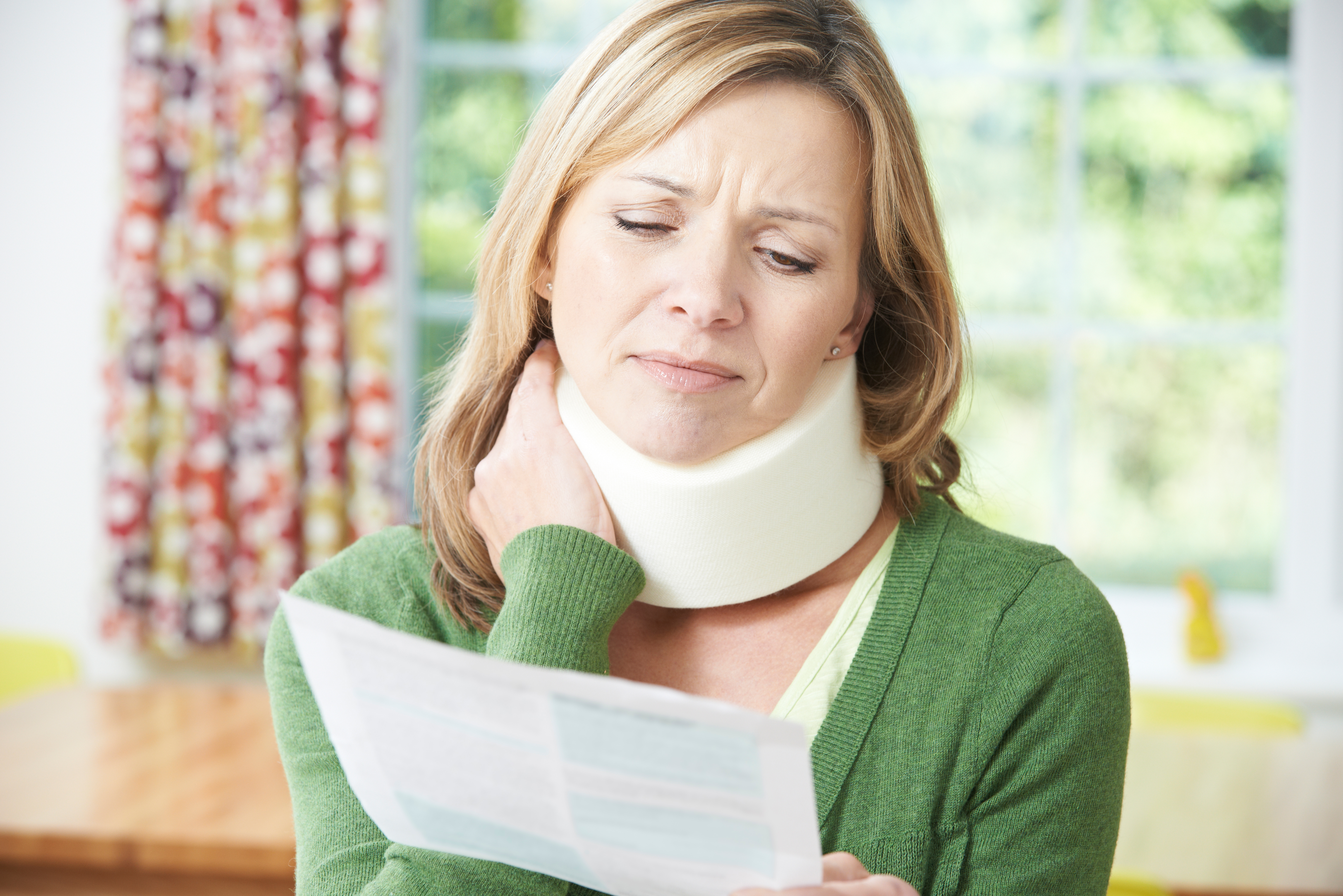 Woman with a neck injury, realizing she should go to Kate Frame Acupuncture for treatment.